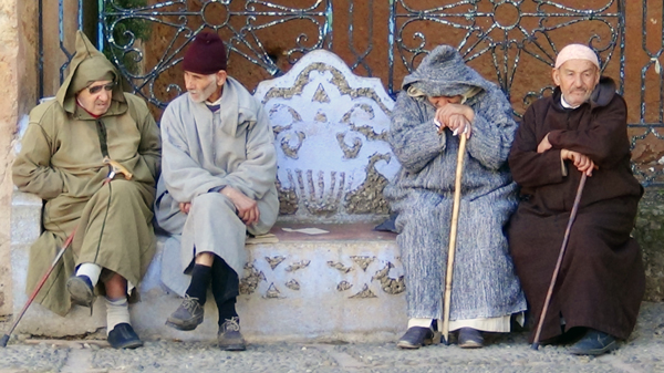 Traveling in Morocco - The Sights of Chefchaouen - Old Men in Jalabas on a Park Bench