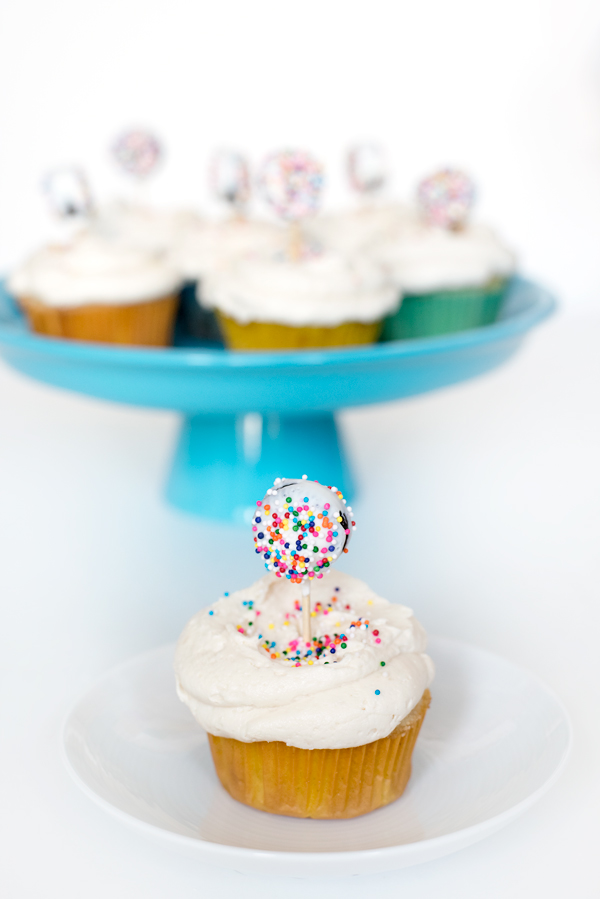 Vanilla cupcakes stuffed with a colorful cake pop